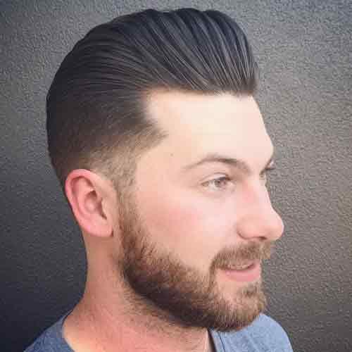 low-taper-fade-con-pompadour-clásico-y-barba-llena