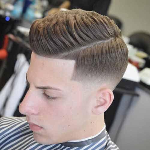 skin fade bajo con pelo en forma y grueso hacia arriba